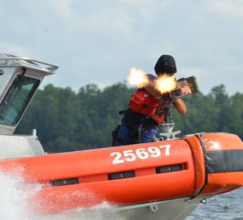 uscg-tactical-bow-gunner-course-tbgc-fires-blank-ammunition-at-a-target-vessel-during-a-simulated-non-compliant-scenario-at-camp-lejeune-nc