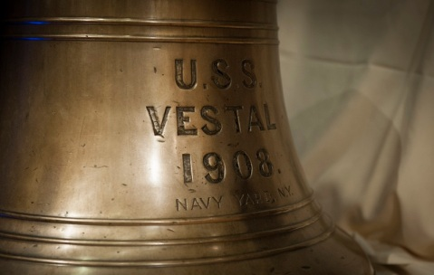 161206-N-ES994-001 WASHINGTON (Dec. 6, 2016) Naval History and heritage Command (NHHC) provided the bell from USS Vestal for display during a commemoration for the 75th Anniversary of the Pearl Harbor Attack, hosted by the Office of the Chief of Naval Operations (OPNAV) and held in the Pentagon's auditorium. the commemoration. Vestal was among the ship's damaged during the Pearl Harbor attack. (U.S. Navy photo by Chief Petty Officer Elliott Fabrizio/Released)
