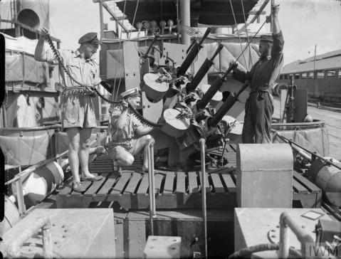 THE ROYAL NAVY DURING THE SECOND WORLD WAR (A 13617) Cleaning and re-ammunitioning the 0.5 inch Vickers machine guns in quadruple Mark III mounting on board HMS CALM in a port in the eastern Mediterranean. The little ship is a minesweeper doing one of the most important, most dangerous and most uncomfortable war jobs. Copyright: © IWM. Original Source: http://www.iwm.org.uk/collections/item/object/205186153