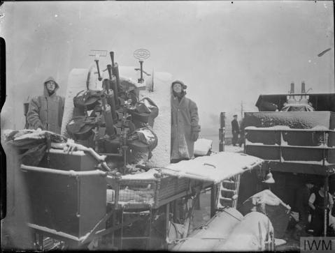 THE ROYAL NAVY DURING THE SECOND WORLD WAR (A 3154) The crew of a quadruple Vickers 0.5 inch machine gun at action stations on a destroyer in wintry conditions. Copyright: © IWM. Original Source: http://www.iwm.org.uk/collections/item/object/205185243
