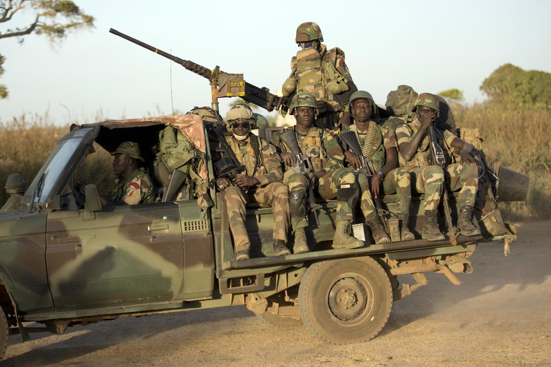 ECOWAS Senegalese troops hold their position in Barra, across from the Gambian capital Banjul Sunday, Jan. 22, 2017, one day after Gambia's defeated leader Yahya Jammeh departed from the country. ECOWAS troops are moving in to prepare for the return of newly installed President Adama Barrow.(AP Photo/Jerome Delay)