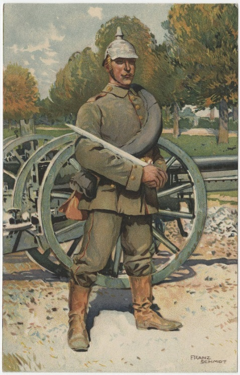 German gunner at a gun park. He is standing in front of cannons, holding an artillery short sword