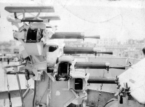 "Vickers Quadruple 0.5"" MG, possibly a Mk3, fired a 1.3 Ounce bullet, rate of fire 600 RPM from 4 200 round magazines, max range 1,500 yards, max elev 80 degrees with 360 firing. This one is HMS Hero (H 99), later HMCS Chaudière, an H-class Destroyer with Vickers Mk III mount. She was paid off and scrapped in 1950."