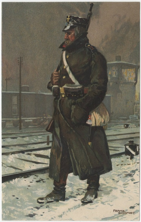 Landstrum soldier at a railway station. There is snow on the ground, and a train sits on a track in the background.