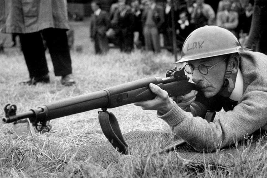 LDV ( Local Defence Volunteers – forerunner of the Home Guard) in instructed on how to fire a rifle at the National Shooting Centre in Bisley, Surrey, 22 June 1940. Note the P14 Enfield. jpg