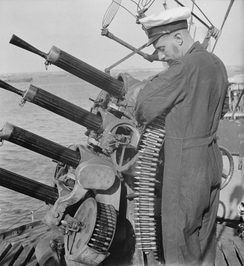 Loading the drums of a 0.50 Vickers Mark III quad mount on the light cruiser HMNZS Leander. She was scrapped in 1950