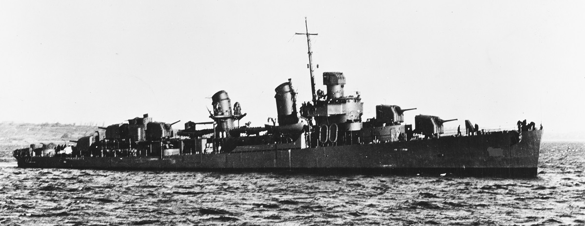 (DD-508) Photograph taken circa late 1942. Note her dark scheme. This view has been heavily retouched by wartime censors to hide radars atop her Mark 37 gun director and foremast, and the hull number on her bow. Official U.S. Navy Photograph, from the collections of the Naval History and Heritage Command. Catalog #: NH 104873