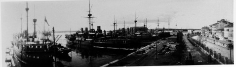 RUDOLF is the single masted ship in the center. The large ship at left is CUSTOZA. The stack and mast to starboard of RUDOLF belong to MONARCH, and the ship to starboard of her is smaller near-sister KRONPRINZESSIN ERZHERZOGIN STEPHANIE. Photographed at Pola. Courtesy of the International Naval Research Organization, Karl Gogg collection. NH 87062