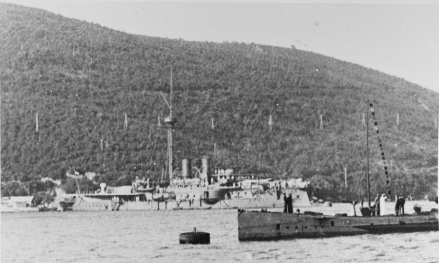 Photographed circa 1915 as a sad, gray station-ship in the Gulf of Cattaro. The sub in the foreground is SMS U-3 or U-Courtesy of the INT'L Naval Research Org., Karl Gogg Collection #14-20.NH 87063