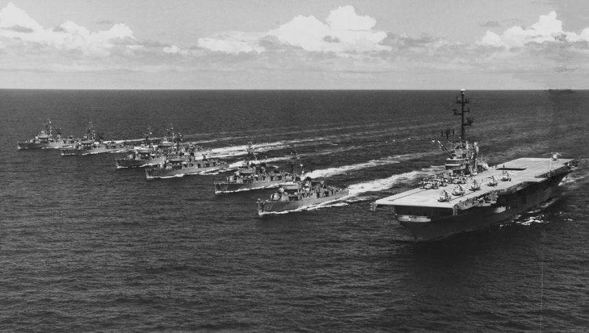 Task Force ALFA, an experimental group specializing in developing ASW tactics, during anti-submarine exercises in the Atlantic, 1959. The other ships present are (from left): USS Murray (DDE-576), USS Beale (DDE-471), USS Bache (DDE-470), USS Eaton (DDE-510), USS Conway (DDE-507), USS Cony (DDE-508), USS Waller (DDE-466) and USS Valley Forge (CVS-45). This force, changing out Randolph for Valley Forge, sailed together during the Cuban Missile crisis. Photograph was released for publication on 3 August 1959. Official U.S. Navy Photograph, from the collections of the Naval History and Heritage Command. NH 96944