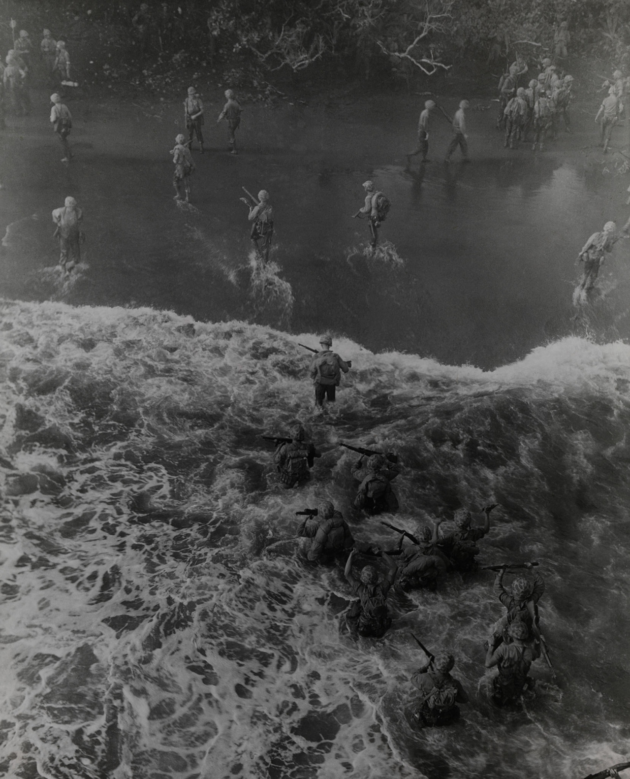 the-marines-land-marines-hit-three-feet-of-rough-water-as-they-leave-their-lst-to-take-the-beach-at-cape-gloucester-december-26-1943