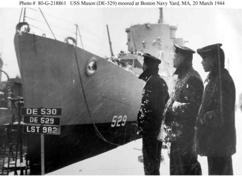 African-American crewmembers look proudly at their ship while moored at the Boston Navy Yard, Massachusetts, 20 March 1944. Official U.S. Navy Photograph, now in the collections of the National Archives. Catalog #: 80-G-218861