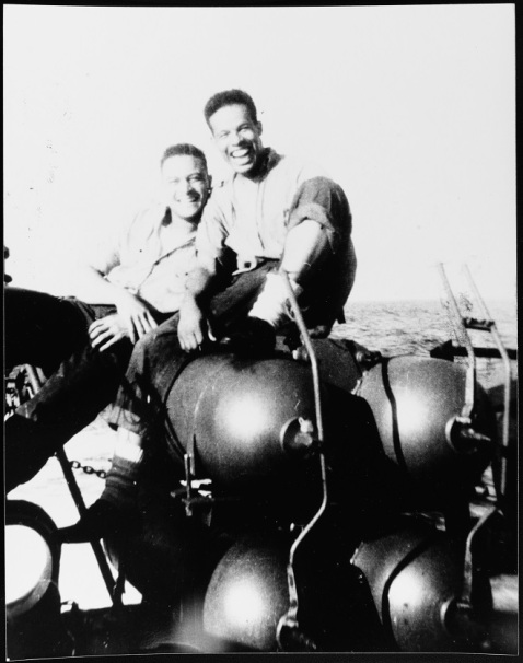 Radarman Kieffer (left) and Radioman Graham (right) relaxing on smoke generators on Mason's fantail somewhere in the North Atlantic while on convoy duty, 1944. Donation of James W. Graham, 1991. U.S. Naval History and Heritage Command Photograph. Catalog #: NH 106731