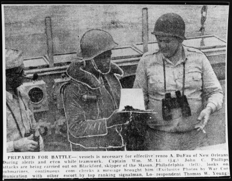 Half-tone image taken from an unknown newspaper. Lieutenant Junior Grade Phillips, Communication Officer, looks on as Top Rank Signalman Lorenzo DuFau hands Captain Blackford a message. They are pictured on the flying bridge during North Atlantic convoy duty, 1944. Donation of James W. Graham, 1991. U.S. Naval History and Heritage Command Photograph. Catalog #: NH 106732