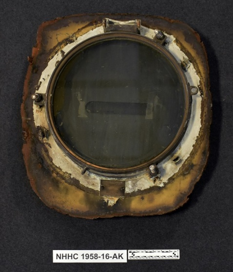 One of six porthole frames and covers removed from the bridge of USS Enterprise (CV-6) in 1958. These portholes were installed in the Captain's cabin aboard USS Enterprise (CVN-65) and are slated to be installed aboard the next ship to bear the name of Enterprise, CVN-80.