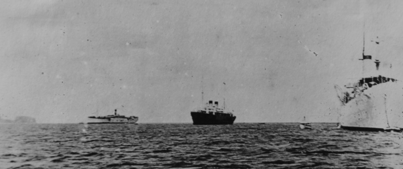 USS Supply, Guam's station ship, left, with SMS Cormoran in the center