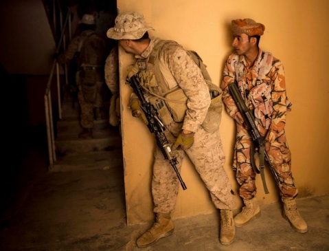 RABKUT, Oman (Feb. 26, 2017) U.S. Marine Lance Cpl. Christopher Aquino-Williams, an infantryman with Company A, Battalion Landing Team 1st Bn., 4th Marines, 11th Marine Expeditionary Unit (MEU), peeks behind a corner before leading soldiers with the Royal Army of Oman (RAO) into a building while conducting Military Operations on Urban Terrain (MOUT) training as part of Exercise Sea Soldier '17 at Rabkut, Oman, Feb. 26. During the training, Marines coached the Omani soldiers and supervised each team execute room clearing techniques. Sea Soldier 2017 is an annual, bilateral exercise conducted with the Royal Army of Oman designed to demonstrate the cooperative skill and will of U.S. and partner nations to work together in maintaining regional stability and security. The 11th MEU is deployed in the U.S. 5th Fleet area of operations in support of maritime security operations designed to reassure allies and partners, preserve the freedom of navigation and the free flow of commerce and enhance regional stability. (U.S. Marine Corps photo by Cpl. April L. Price)