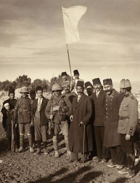 The Mayor of Jerusalem Hussein Effendi el Husseini [al-Husseini] (Ottoman), meeting with Sergts. Sedgwick and Hurcomb of the 2/19th Battalion, London Regiment, under the white flag of surrender, Dec. 9th [1917] at 8 a.m., 1917.