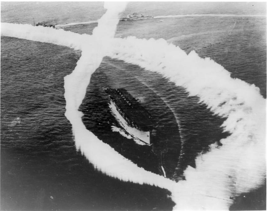 Aircraft lay a smokescreen over USS Langley (CV-1) during fleet maneuvers in 1930