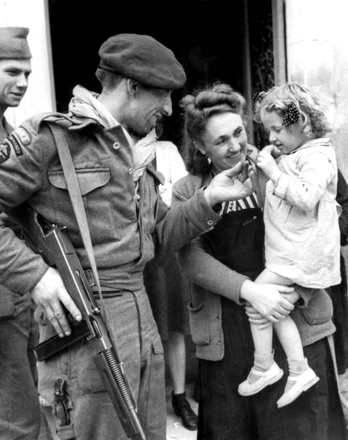 French villagers welcome French Naval Commandos who D-Day landings. thompson tommy gun Near Amfreville, Calvados, Lower Normandy, France. 17 June 1944.