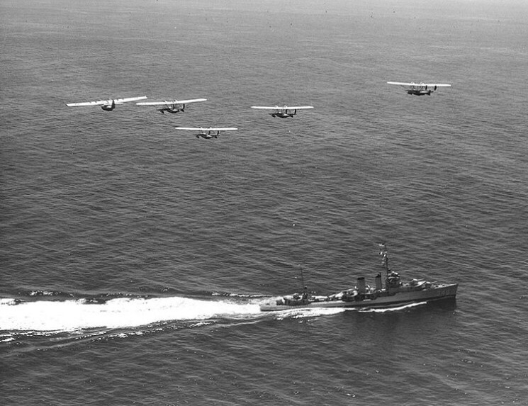 USS Farragut (DD-348) staged for Movietone News, off San Diego, California, 14 Sept 1936. At left is a PBY-1 of Patrol Squadron Eleven-F (VP-11F). The other four are P2Ys of Patrol Squadron Seven-F (VP-7F)