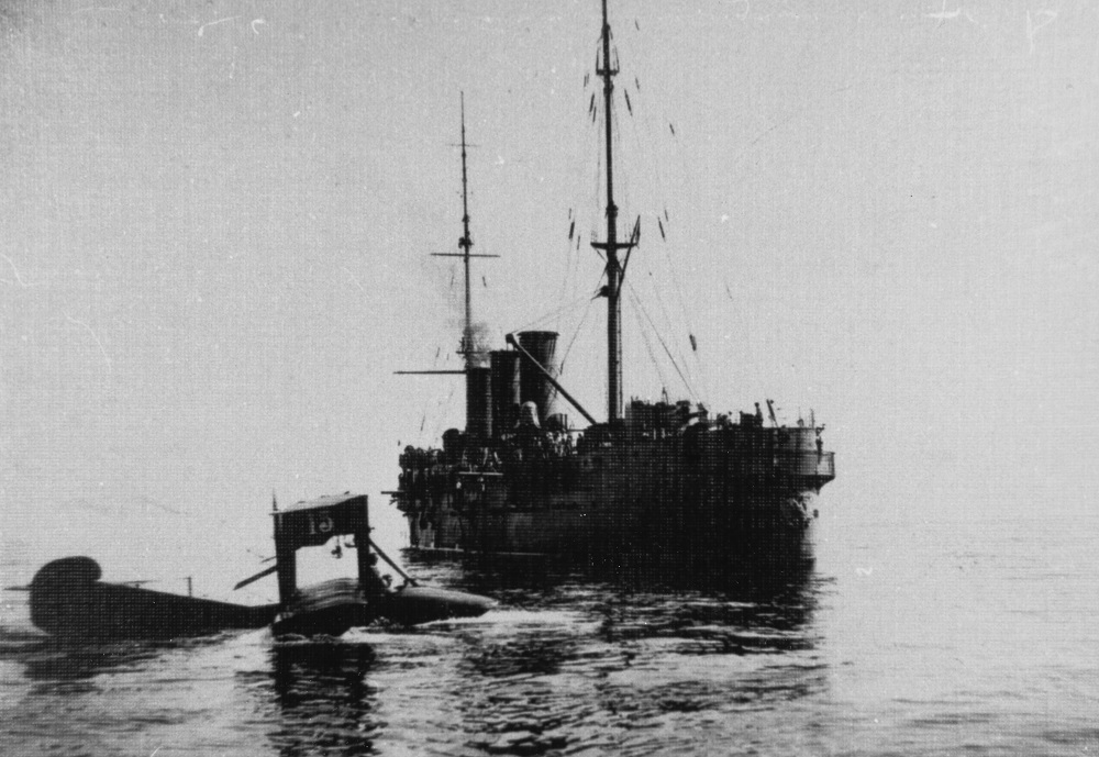 Russian Navy Curtiss F-type flying boat serial number 15 seen in the Black Sea, with the cruiser KAGUL (1902-1933) in the background. Information accompanying this photograph indicates that it was taken during the 28 March 1915 operation off the Bosporus. Description: Courtesy of Mr. Boris V. Drashpil of Margate, Florida, 1984.Catalog #: NH 100153
