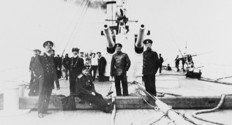 Unidentified personnel seen on deck aboard the protected cruiser KAGUL (1902-1934) in The Black Sea on 20 March 1915. A twin 152mm/ 6-inch, 45-caliber gun turret appears in the center. Description: Courtesy of Mr. Boris V. Drashpil of Margate, Fla., 1983 Catalog #: NH 94406