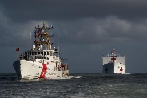 The crew of the Coast Guard Cutter Joesph Tazanos, a fast response cutter, escorts the Military Sealift Command hospital ship USNS Comfort (T-AH 20) into San Juan, Puerto Rico, Oct. 3, 2017. U.S. Coast Guard photo by Petty Officer 2nd Class Meredith Manning