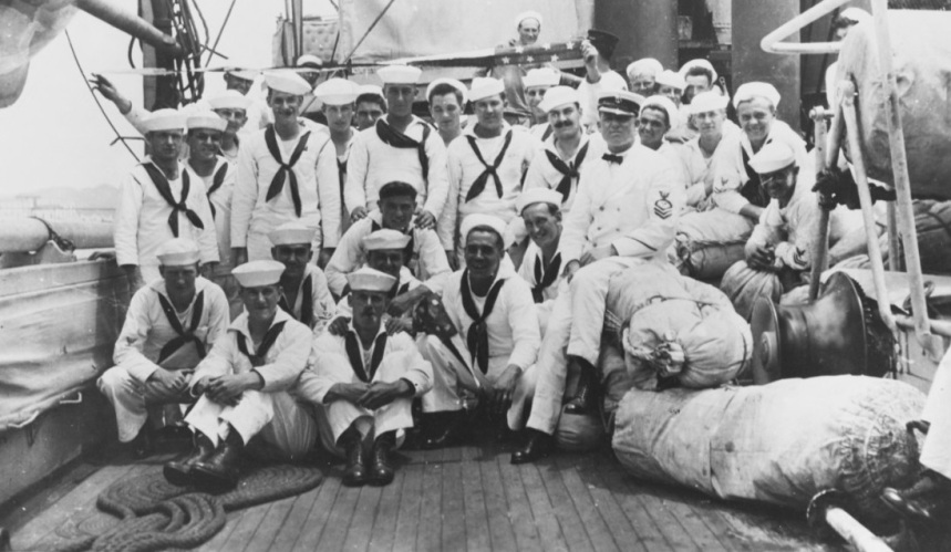 Crewmen in whites pose amidships with sea bags and her commissioning pennant, circa 1918-19. Description: Courtesy of Paul H. Silverstone, 1983 NH 94994