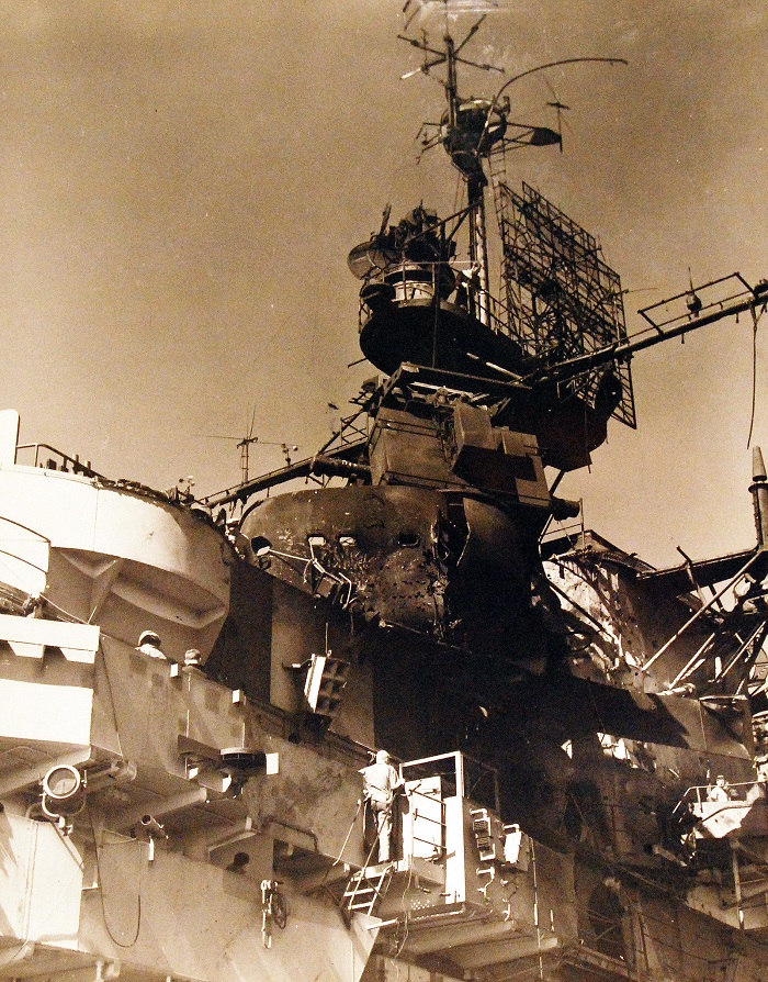 USS Ticonderoga (CV 14). Shown Damage to island structure from Japanese kamikaze dive from the night of 20-21 January 1945 80-G-264996