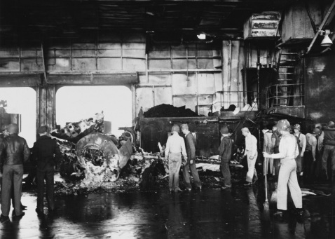 Wrecked plane on the hangar deck, after fires where the first Kamikaze hit received off Formosa, 21 January 1945. 80-G-273213