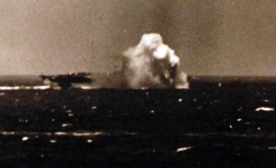 During air action off Luzon, the Philippines, Japanese Zero fighter in a suicide crash dive registers a near miss on USS Ticonderoga (CV 14) November 5, 1944 80-G-289986