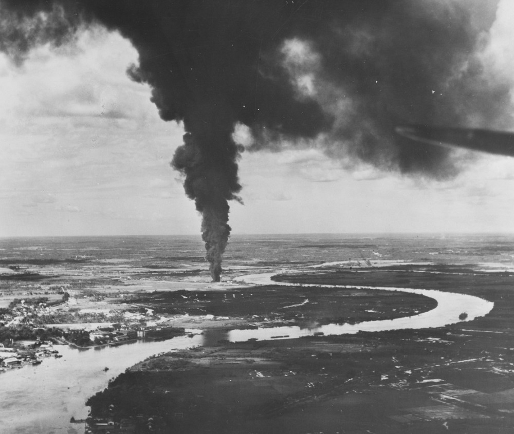 Saigon River Front, French Indochina, Caption: Ships and installations afire after aerial attack by carrier-based planes of US Pacific fleet, 12 January 1945. Taken by plane from USS TICONDEROGA (CV-14) #: 80-G-301944