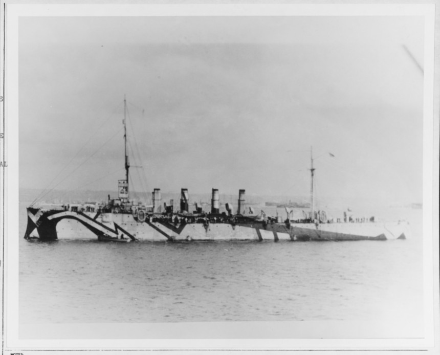 USS Birmingham (Scout Cruiser # 2) In Brest harbor, France, on 15 October 1918. During 1917-1918 she was flagship of U.S. Forces at Gibraltar and escorted convoys in the eastern Atlantic. Note her dazzle camouflage. Courtesy of John G. Krieger, 1966-1967. NH 56393