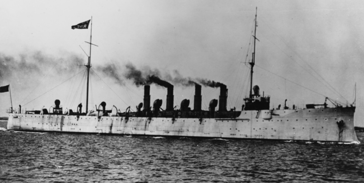 USS Birmingham (Scout Cruiser # 2) Running sea trials in March 1908. She is flying the flag of her builder, the Fore River Shipbuilding Company of Quincy, Massachusetts, from her mainmast. NH 56390