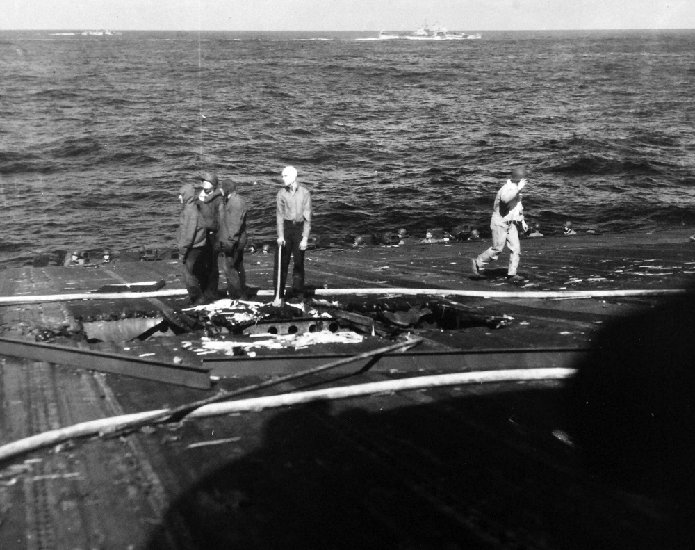 USS Ticonderoga (CV 14). Shown: Damage to the flight deck from Japanese kamikaze dive from the night of 20-21 January 1945. Photographed by PHOM Peters and PHOM Quillinan, January 22, 1945. 80-G-264995