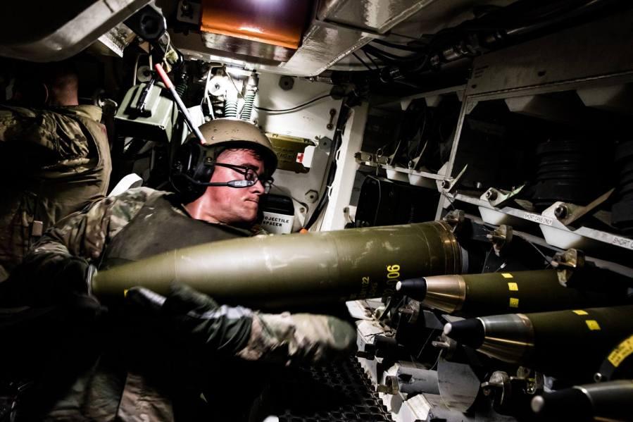 M109A7 Paladin 155mm artillery round into an ammo rack