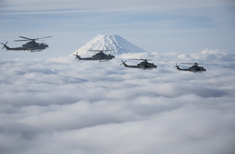 Marine Light Attack Helicopter Squadron 267 AH-1Z Viper and UH-1Y Venom helicopters past Mount Fuji, Shizuoka, Japan, March 12, 2017. The squadron, currently supporting Marine Aircraft Group 36, 1st Marine Aircraft Wing, III Marine Expeditionary Force, validated the long-range capability of auxiliary fuel tanks on their H-1 platform helicopters by flying 314 nautical miles during one leg of the four-day mission, March 10. These aircrafts' extended range is crucial to maintaining a stronger, more capable forward-deployed force in readiness in the Indo-Asia-Pacific region. The squadron is based out of Camp Pendleton, California. (U.S. Marine Corps photo by Lance Cpl. Andy Martinez)