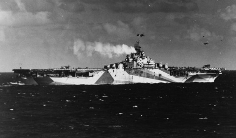 USS Ticonderoga (CV-14) At sea off the Philippines, just prior to her first strike against the Japanese, 5 November 1944. The ship is painted in camouflage Measure 33, Design 10a. NH 92243