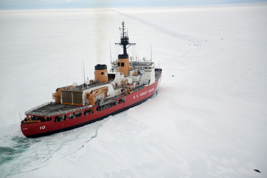 The Coast Guard Cutter Polar Star cuts through Antarctic ice in the Ross Sea near a large group of seals as the ship's crew creates a navigation channel for supply ships, Jan. 16, 2017. The resupply channel is an essential part of the yearly delivery of essential supplies to the National Science Foundation's McMurdo Station. (U.S. Coast Guard photo by Chief Petty Officer David Mosley)