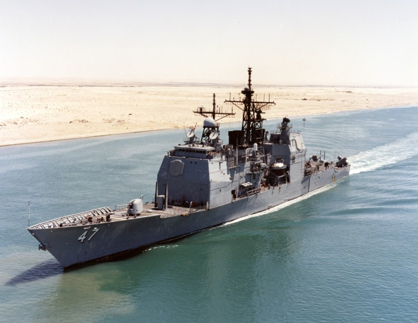USS Ticonderoga (CG-47) Transiting the Suez Canal enroute to the Mediterranean Sea, following a deployment in support of Operation Desert Shield, 22 August 1990. Photographer: PH3 Frank A. Marquart. NH 106516-KN
