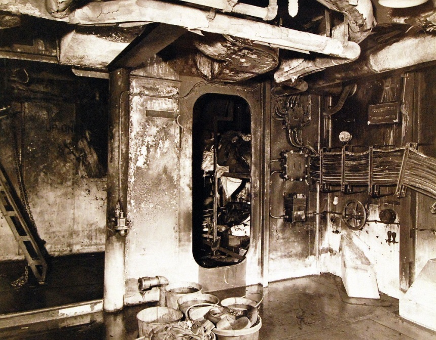 USS Ticonderoga (CV 14). Damage to hangar deck from Japanese kamikaze dive from the night of 20-21 January 1945 80-G-264994