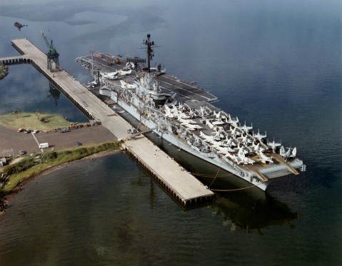 USS Ticonderoga (CVA-14) moored at a pier, probably at Pearl Harbor, Hawaii. On deck are various aircraft of Carrier Air Group 5 (CVG-5) which had been assigned to the Ticonderoga for a deployment to the Western Pacific from 10 May 1961 to 15 January 1962. U.S. Navy National Museum of Naval Aviation photo No. 1996.488.039.045