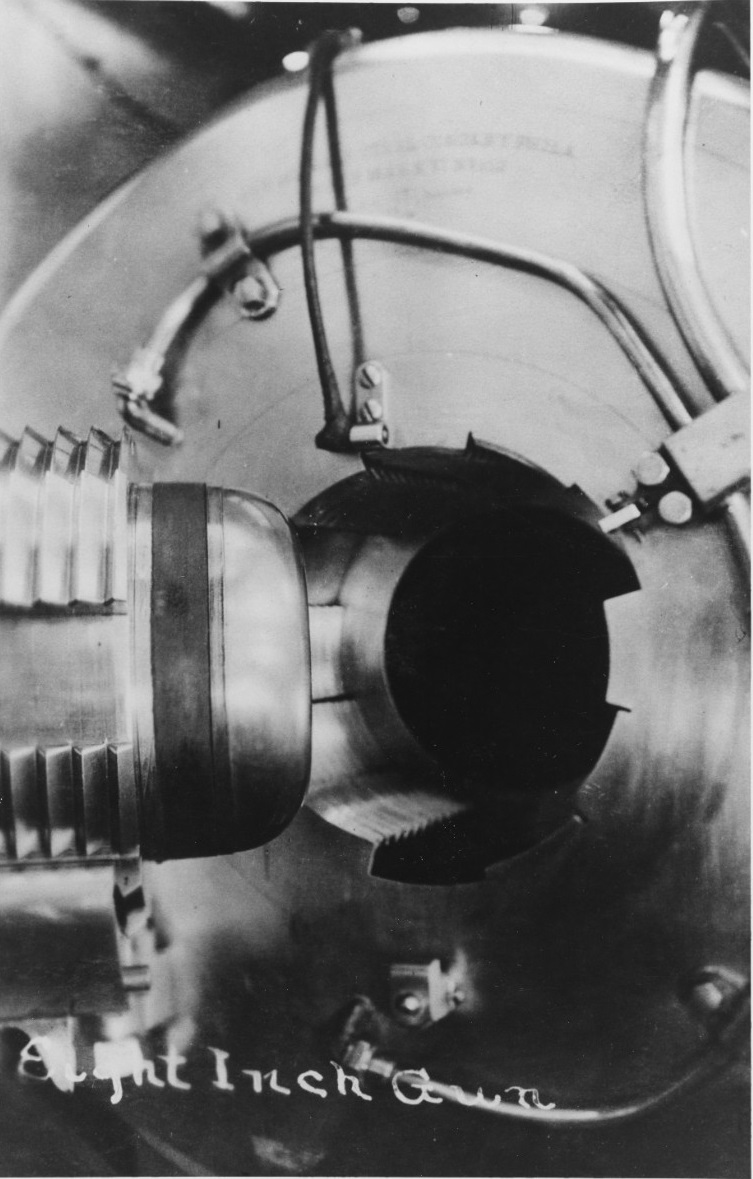 """USS SAN DIEGO (CA-6) Breech of one of her 8""""/45 guns, taken circa 1916. Her magazine carried 125 shells for each of the four tubes. These latter guns proved capable enough for the Army to use surplus specimens in the 1920s for Coastal Defense purposes. Courtesy of Chief Watch Officer James B. Dofflemeyer, 1972. NH 82995"""