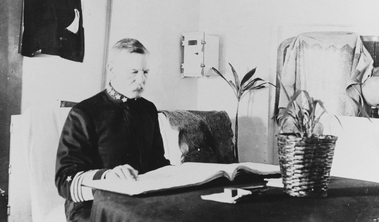 Admiral Thomas B. Howard (USNA 1873), Commander, Pacific Fleet, in his cabin aboard USS SAN DIEGO (CA-6), circa 1915. At the time he was only the fifth full admiral in the history of the U.S. Navy-- after Farragut, Porter, Dewey and Frank F. Fletcher. More than 220 have followed, somewhat diluting the brand. Courtesy of D.M. McPherson, 1976 NH 84403