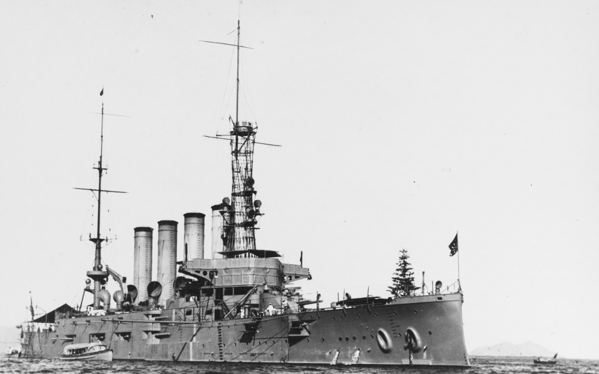 """USS San Diego (Armored Cruiser No. 6) Off Guaymas, Mexico, 26 December 1915. Starting in 1913 and continuing through 1915, California was a common sight in Mexico's Pacific waters where was """"observing conditions"""" brought about by the Mexican revolution and civil war. Photographed by Hopkins. Note Christmas tree mounted on her forecastle. Collection of Thomas P. Naughton, 1973. NH 92174"""