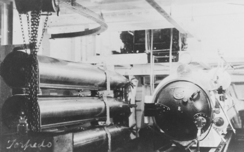 USS SAN DIEGO (CA-6) View in the torpedo tube room, with a torpedo tube at right, and torpedo afterbodies at left, circa 1916. Courtesy of Chief Watch Officer James B. Dofflemeyer, 1972. NH 82999
