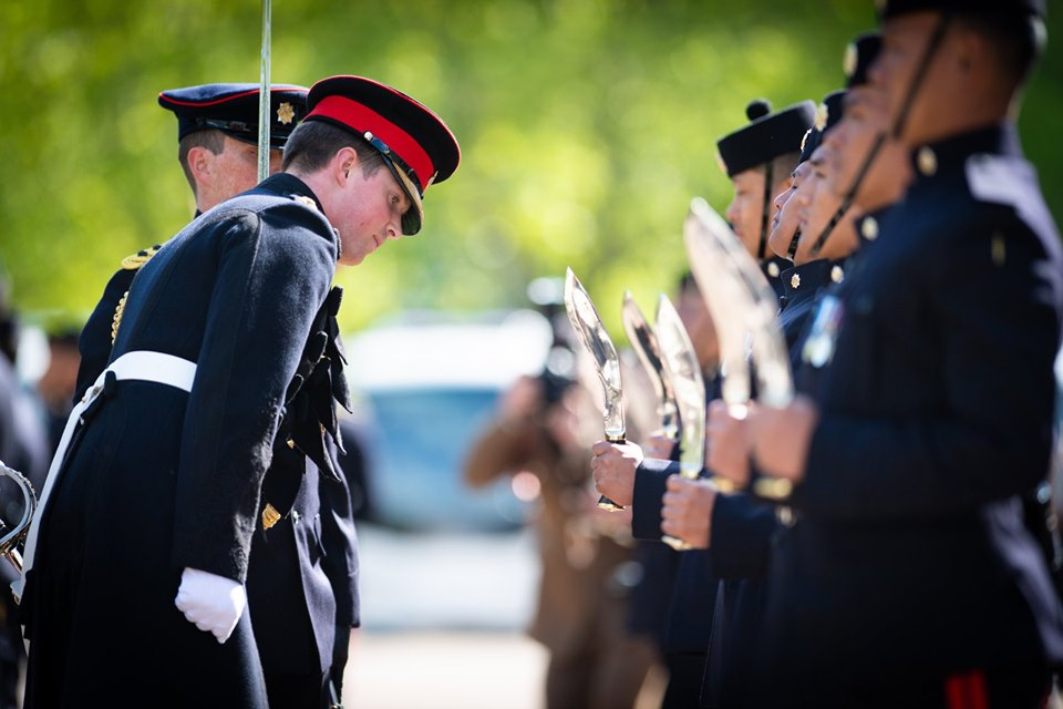 The Staff Captain, Captain Tom Mountain inspects every detail during the inspection of The Queen's Own Gurkha Logistic Regiment.