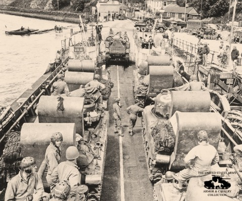 4 June 1944, this photo shows the 70th Tank Battalion embarking its vehicles onto a LCT (Landing Craft, Tank) in southern England. Soon men and machines would cross the English Channel toward their landing site at UTAH Beach. The M4 and M4A1 Sherman tanks seen here are equipped with wading trunks, which allowed the tanks to ford short distances through water from the landing craft to the beach without drowning out the engine. Interestingly, the lead vehicle loading onto the front of the craft is the unit's T2 Tank Recovery Vehicle