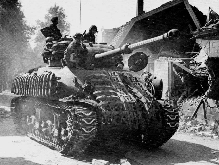 """Originally formed as the New Brunswick Regiment of Yoemanry Cavalry in 1848, the 8th Hussars (PL) are now and have traditonally been the """"local regiment"""" in NB. Here, an M4 Sherman of the 5th Armoured Regiment (8th Princess Louise's (New Brunswick) Hussars, CAC, CASF, moves around """"somewhere in Italy"""" in 1943-44."""